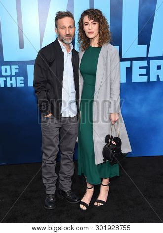 LOS ANGELES - MAY 18:  Breckin Meyer and Linsey Godfrey arrives for the 'Godzilla: King of the Monstersl' Hollywood Premiere on May 18, 2019 in Hollywood, CA