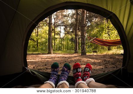 Young Couple Resting In Camping Tent, View From Inside
