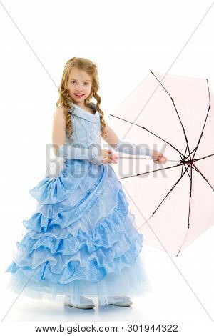 Beautiful Little Girl Princess, In A Long Dressy Dress Under An Umbrella. Concerts Style And Fashion
