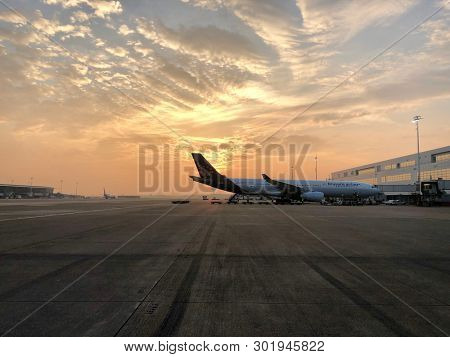 BRUSSELS, BELGIUM - MAY 18, 2019: Sunrise over passenger airliners parked at Brussels Zaventem International Airport in Brussels, Belgium.