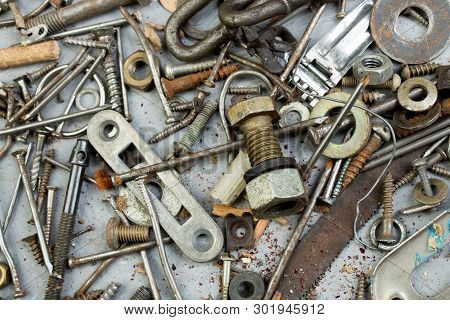 Nuts, Washers, Bolts, Screws Of Various Sizes And Shapes Over The Plain Background. A Set For The Me