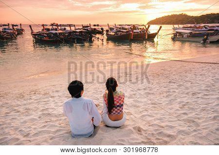Couple Relaxing Beautiful Sunset On Koh Lipe Beach Thailand ,summer Vacation