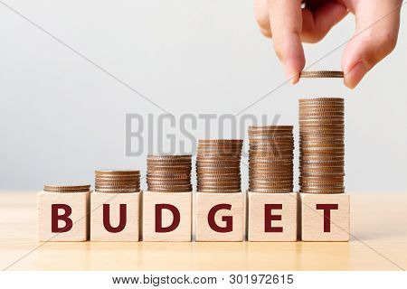 Hand Putting Coins On Stack Stair As Step Growing Growth And Wooden Cube Block With Word Budget. Mon