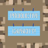 Conceptual hand writing showing Productive Capacity. Business photo text the maximum possible output of a production plant Strip Size Lined Paper Sheet Hanging Using Blue Clothespin. poster