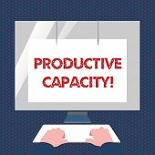 Conceptual hand writing showing Productive Capacity. Business photo text the maximum possible output of a production plant Hands on Keyboard Front White Monitor with Screen Protector. poster
