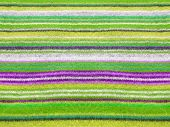 Vibrant colorful alpaca striped sweater texture closeup. poster