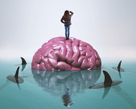 Woman Standing On Human Brain In Water Surrounded By Sharks.