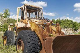 Old Yellow Demiolished, Cracked And Abandoned Excavator