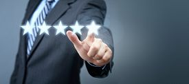 Businessman pointing to five star service rating symbol with copy space