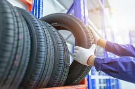 Tires In A Tire Store, Spare Tire Car, Seasonal Tire Change, Car Maintenance And Service Center. Veh