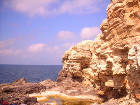 Red Rock And Blue Sea
