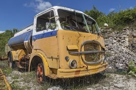 Old Yellow Abandoned Industrial Truck In Quarry