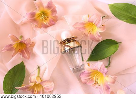 Pink Daylily Flowers With A Bottle Of Eau De Toilette, Top View, Close-up