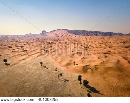 Scenic Fossil Rock In The Sharjah Desert Of The United Arab Emirates Aerial View. Sand Meeting The R