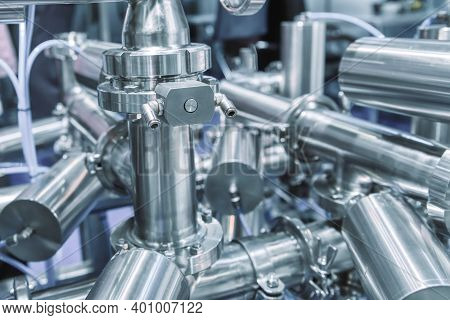 Bright Shiny Stainless Steel Piping. System Of Ball Valves And Metal Piping. Equipment For The Food