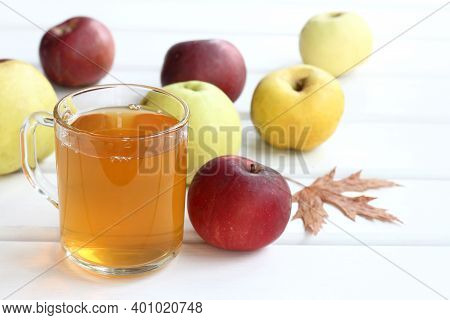 Freshly Squeezed Juice From Red, Yellow And Green Apples. Autumn Vitamin Drink