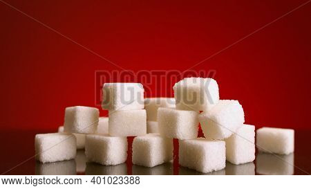Pile Of Sugar Cubes On Isolated Background. Stock Footage. Pile Of Sugar Cubes Changes In Number On