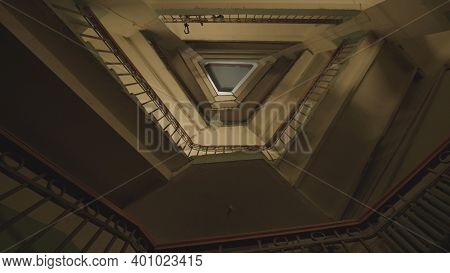 Flights Of Stairs. Stock Footage. Bottom View Of Dizzying Flights Of Stairs. Twisting Stairs In Mult