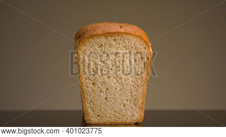 Close-up Of Man Taking Bread. Stock Footage. Loaf Of White Bread With Cut Piece On Isolated Backgrou