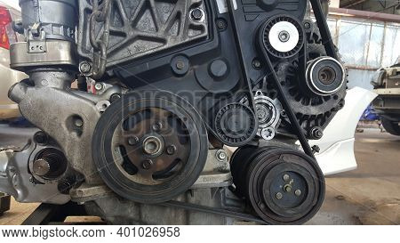 Close-up On A Disassembled Engine With A View Of The Gas Distribution Mechanism, Chain, Gears And Te