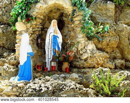 Madonna Figures On Rock Ledge In Malta