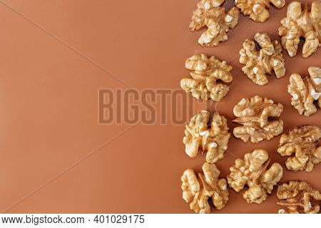 Raw Dried Healthy Walnuts Nuts On A Background