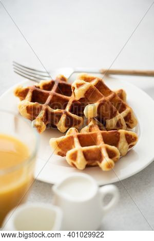 Belgian Waffles On White Plate. Sweet Breakfast Golden Baked Waffles