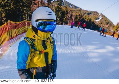 Portrait Of Woman Skier At Sunny Day