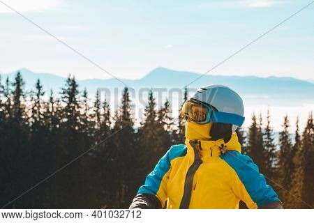 Woman In Ski Equipment Looking At Copy Space