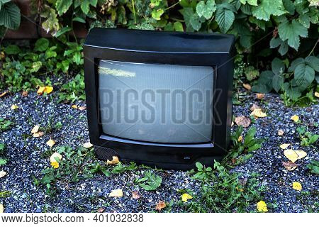 Old Analog Television Set On The Street Outdoor
