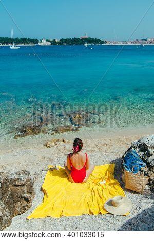 Woman Sunbathing At Sea Beach In Sunny Day