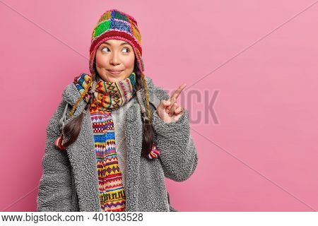 Charming Beautiful Woman In Winter Clothes Points At Upper Right Corner Gives Recommendation To Chec