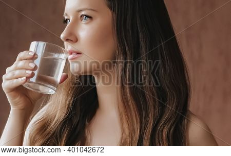 Woman Drinking Water Out Of Glass At Home, Stay Healthy And Hydrated, Diet And Wellness Concept