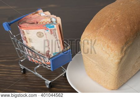 Kazakhstan Tenge Kzt In A Grocery Basket With Bread. Rising Food Prices And Groceries In Kazakhstan