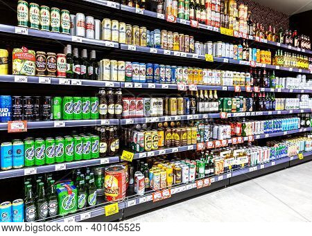 Samara, Russia - October 8, 2020: Various Bottled Low Alcoholic Beverages. Different Beer Cans With