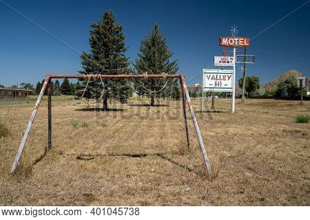 Cokeville, Wyoming - August 6, 2020: Swingset And Playground At An Old Abandoned Seedy Motel