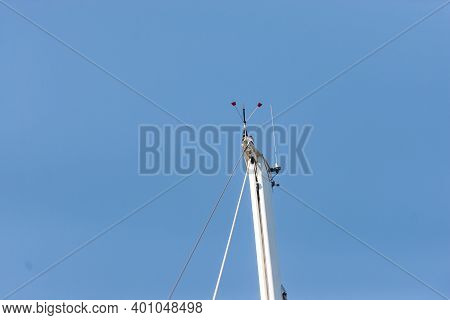 Top Of The Yacht's Mast. Equipment On The Top Of The Mast. Wind Meter And Weather Indicator.