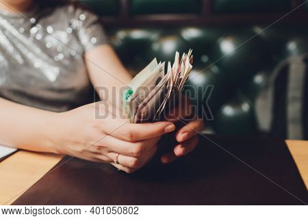 Russian Rubles In The Hand Of A Fan.male Hand Holding Many Of The Russian Banknotes.the Transfer Of