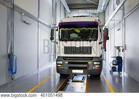 Servicing And Repairing Trucks In A Large Garage. Truck In A Car Service For Diagnostics. Car Servic