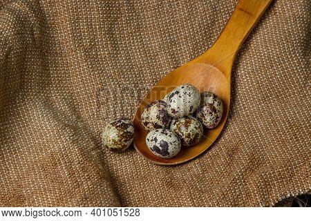 Quail Eggs On Burlap. Healthy Food. Quail Eggs On A Wooden Spoon