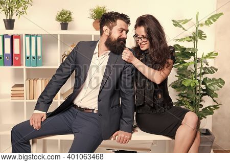 Do What You Love. Couple In Love Sit On Office Desk. Couple Of Business Partners. Professional Coupl