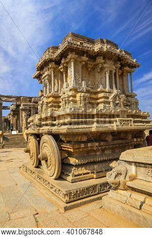 Hampi, India on December 31, 2018 :World heritage site historic Vijaya Vittala temple and Hampi runes in India