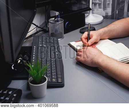 Unrecognizable Businessman Working On Laptop Computer At Home. Internet Marketing, Finance, Business