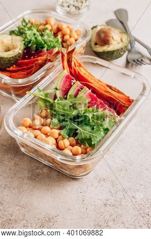 Vegan Healthy Meal Prep Containers. Chickpeas, Sweet Potatoes, Arugula, Radish And Avocado For Lunch
