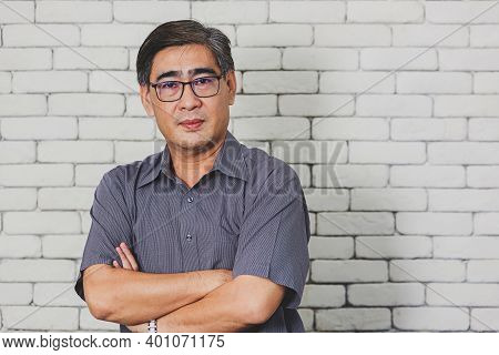 Portrait Of Asian Handsome Senior Elderly Man Wear Eyeglasses On White Brick Wall Background. Old Ma
