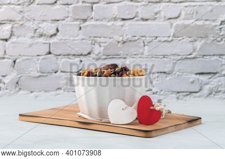 Valentines Day Card Background With Mixed Nuts In White Bowl. Heart Healthy; Mix Of Dried Fruits. Se