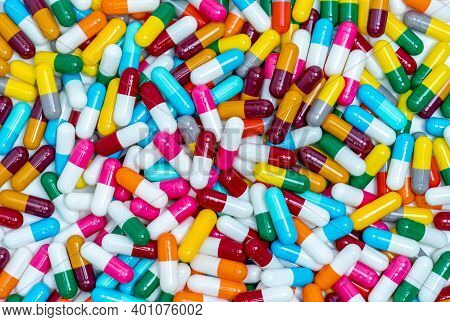 Many Capsule Pills. Top View Capsule Pills. Full Frame Blue, Yellow, Green, Pink, Red, Orange, White