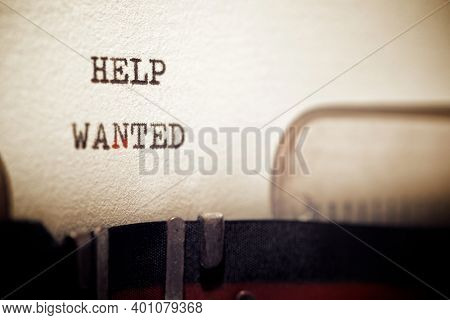 Help wanted phrase written with a typewriter.