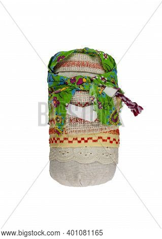 Folk Crafts. Traditional Russian Fabric Doll. A Doll In A Green Shawl. Home Amulet And Childrens Toy