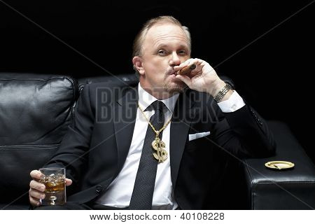 Mafia Boss Smoking A Cigar While Drinking Whiskey